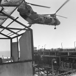 A Marine Utility/Attack Helicopter Squadron 167 (HML/A-167) CH-46E Sea Knight helicopter prepares to transport confiscated military equipment from an Iranian oil platform. The platform was strafed a later destroyed by gunfire from U.S. destroyers.