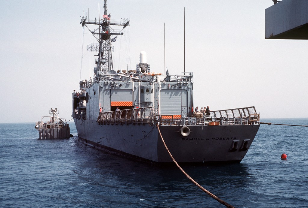 Steel cables are attached to hold <i>Roberts</i> in place above MS2. (PH2 Michael Harnar/U.S. Navy)