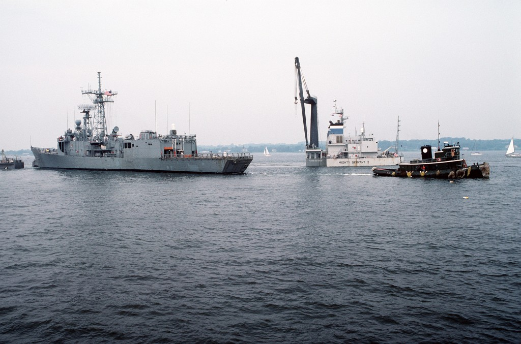 A tugboat pulls <i>Roberts</i> from the heavy-lift ship. (PH2 Elliott/U.S. Navy)