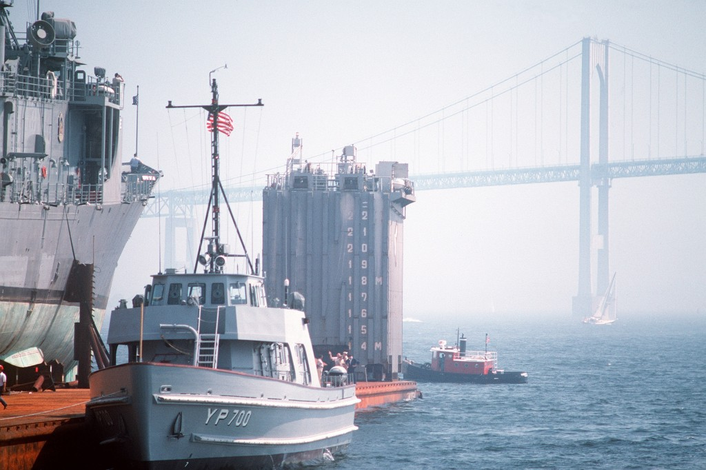 Yard Patrol craft No. 700, part of the Newport Naval Education and Training Center's pocket fleet, comes alongside <i>Roberts</i> not far from the Newport Bridge. (PH2 Elliott/U.S. Navy)