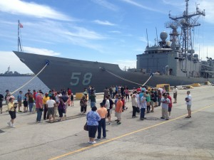 Former Roberts sailors and their families prepare to go aboard during their Mine Blast 25th Anniversary reunion, April 13-14, 2013, in Jacksonville, Fla.
